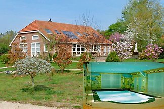 House Iris, max 16/17 persons / max. 10 rooms, private hot pool. 5 bathroom, 2500m2 garden around, next to the nature reserve of Westerwolde.