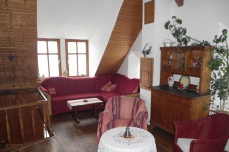Gruppenraum in der Ferienwohnung mit Kaminofen