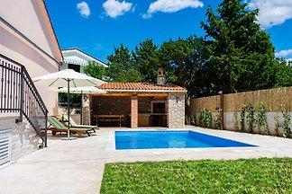 Ferienhaus MASLINA mit Pool