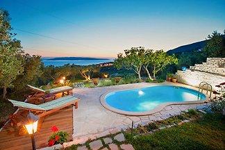 Ferienhaus Elly  Pool und Meerblick