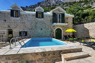 Ferienhaus Topolina mit  Pool
