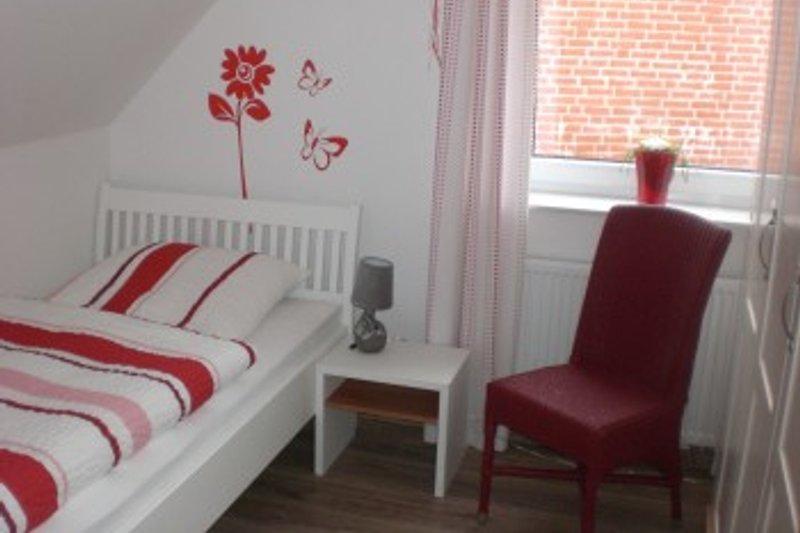 Ferienhaus Ele im Sonnenhof auf BorkumEinzelzimmer oben