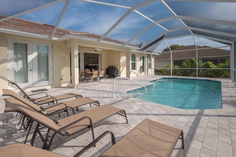 Spacious pool area to south direction with covered lanai