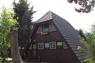 Nur-Dach-Ferienhaus mit Garten
