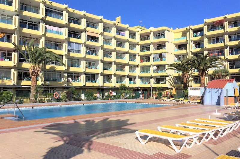 View of the apartments from the swimming pool, apartment is on top floor