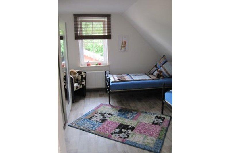 Separates Zimmer mit 2 Einzelbetten im OG