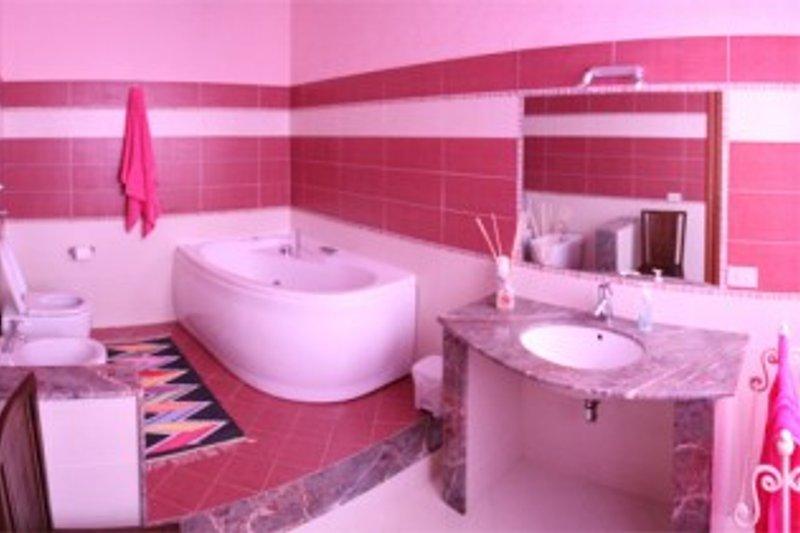 bathroom with whirlpool