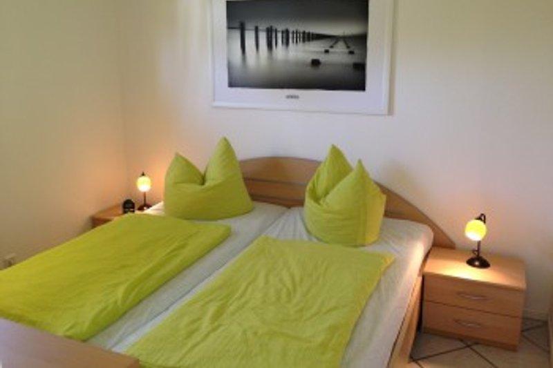 Dünenbungalow II - Schlafzimmer mit Doppelbett