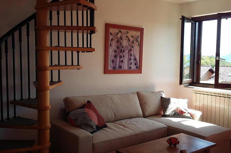 Wohn-/ Esszimmer mit ausziehbarer Schlafcouch für 2 Personen...