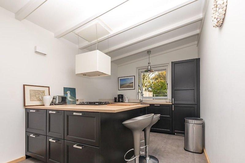 Elzenpad 7 ferienhaus in burgh haamstede mieten for Wohnkuche mit kochinsel