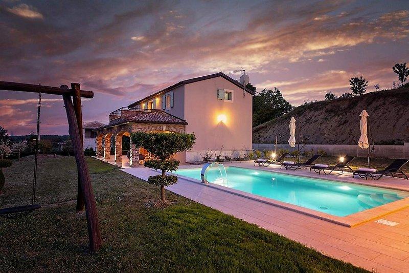 Villa Vista Visinada with pool at night