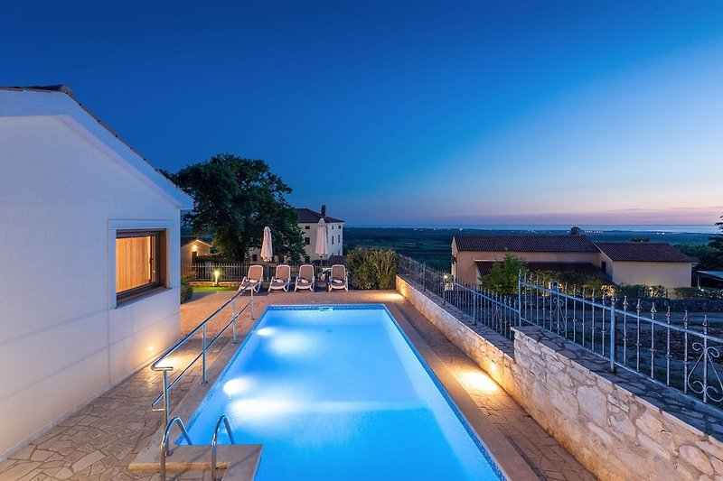 Villa with swimming pool by night