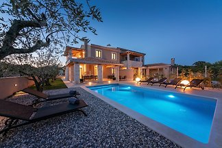 Villa Flora Abrega is a modern holiday home with swimming pool, only 1.9 km from the sea away and it is set up for 6 persons.