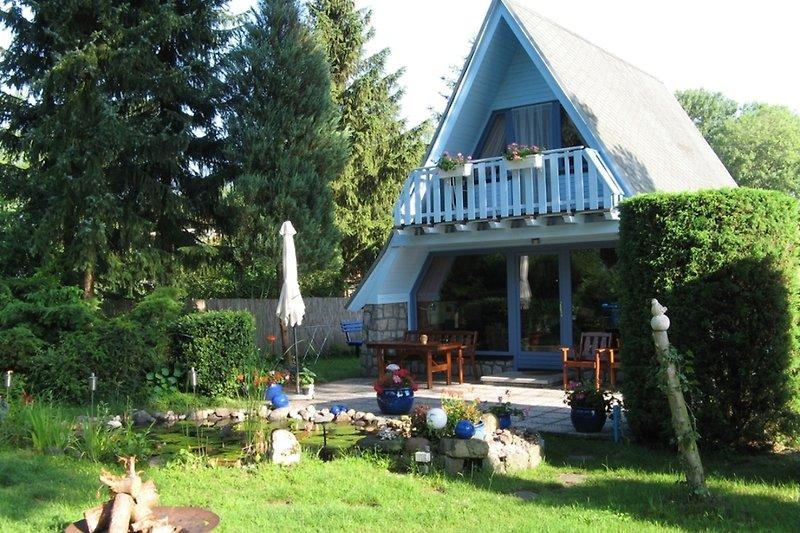 Ferienhaus in Malchow am Fleesensee Garten mit Lagerfeuerstelle