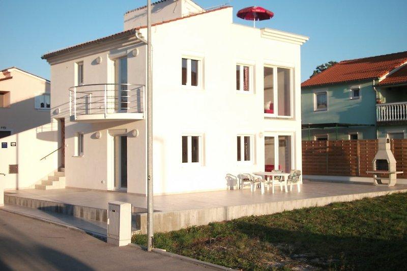 Strandvilla Aurora in der ersten Reihe am Badestrand