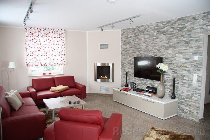 Wohnzimmer mit Sky TV Wlan Kamin