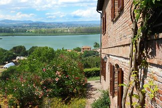 """Casa sul Lago"" is located 2 km outside the resort of Porto on the border between Umbria and Tuscany."