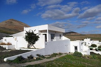 Cheap holiday, a small and 2 larger apartments or a cottage with sea view on a large walled plot in a quiet location.