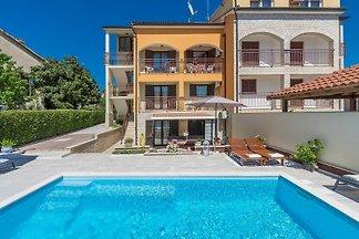Apartment Hajpek I with shared pool