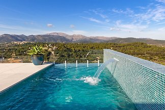 Welcome to this breathtaking and modern house in Búger, with private pool and space for 8 guests.