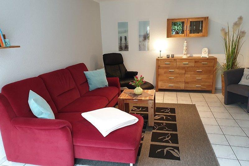 Gemütliche Sitzecke mit Relaxsessel und Schlafsofa