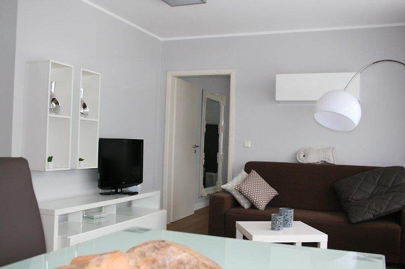 Wohnraum mit Doppelbettcouch SST 4-54