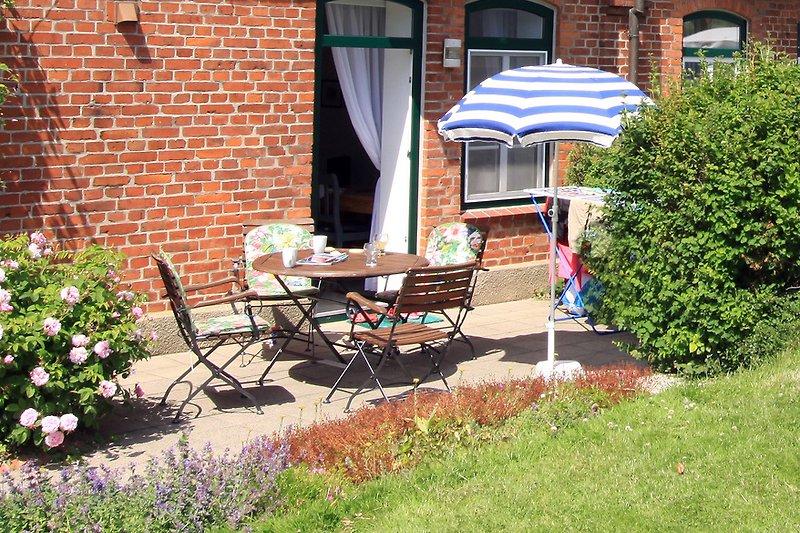 Die Terrasse mit Gartenblick