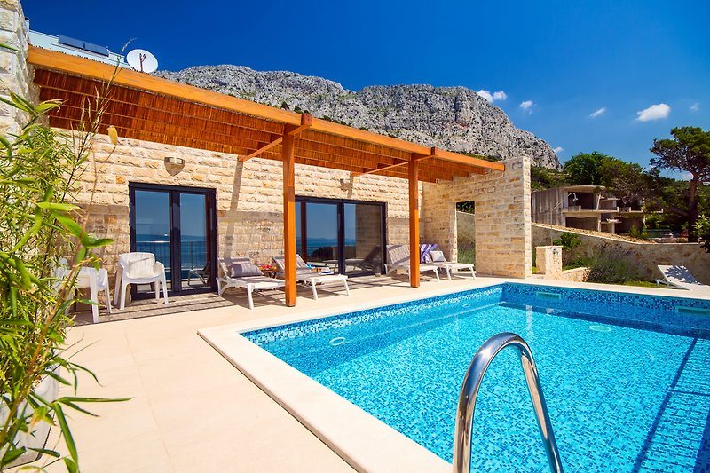 Private heated pool with 8 lounge chairs