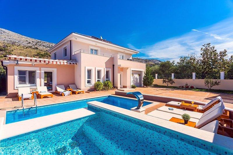 Villa Milia with 24m2 private pool plus 5m2 jacuzzi, gym, sauna, and playground