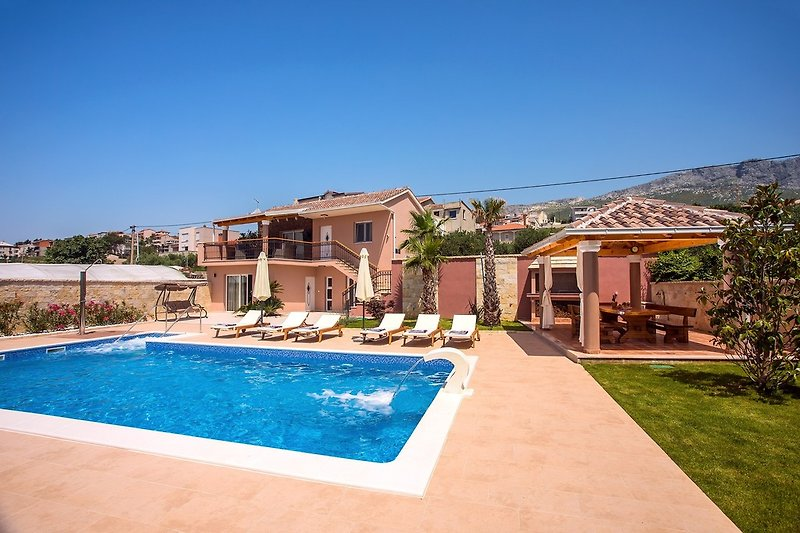 Private, heated 10m x 5m pool with massage system, a very spacious sun deck area