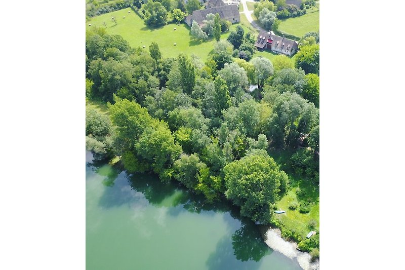 Maison depuis le Doubs