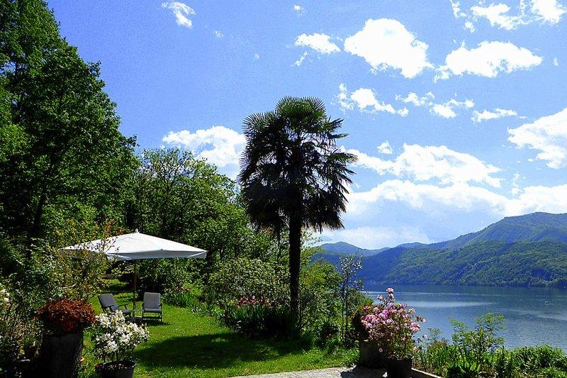 Terrasse + Garten mit Panorama- und Seeblick
