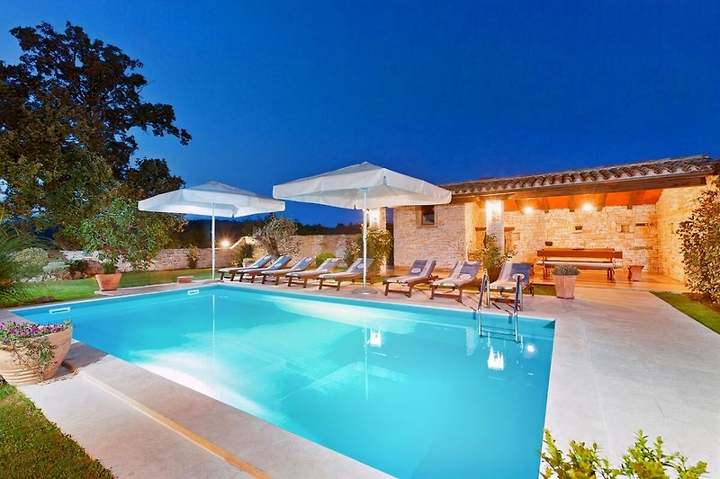 Pool lighting creates a magical outdoor environment