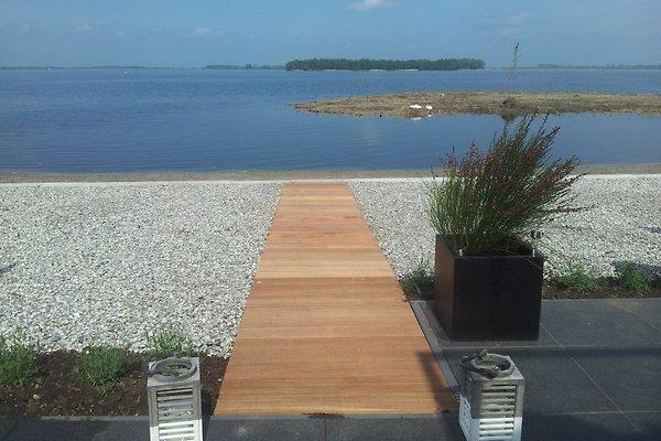 Casa sulla spiaggia sul lago di veluwe appartamento in for Design di architettura casa sulla spiaggia