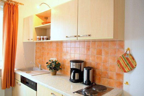 himmelbett wohnung mit terrasse ferienhaus in lancken granitz mieten. Black Bedroom Furniture Sets. Home Design Ideas