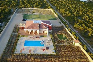 Hacienda with pool and tennis court