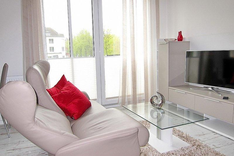 Wohnbereich mit Sofa und Relax-Funktion
