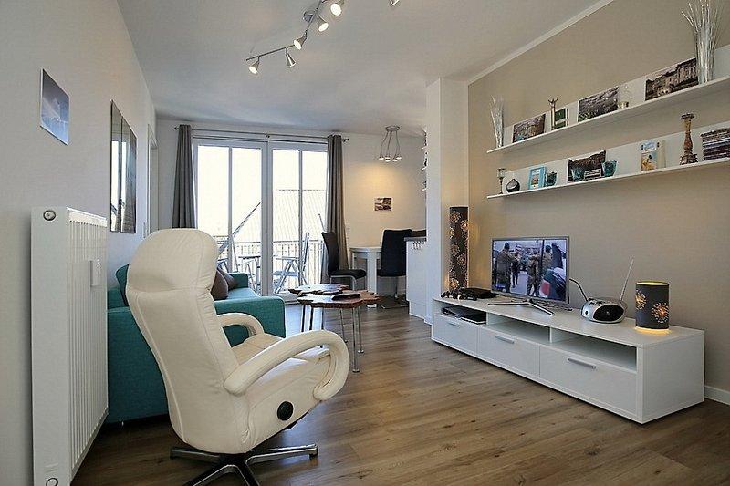Wohnbereich mit Doppelschlafcouch, Flachbild-TV und Playstation 3