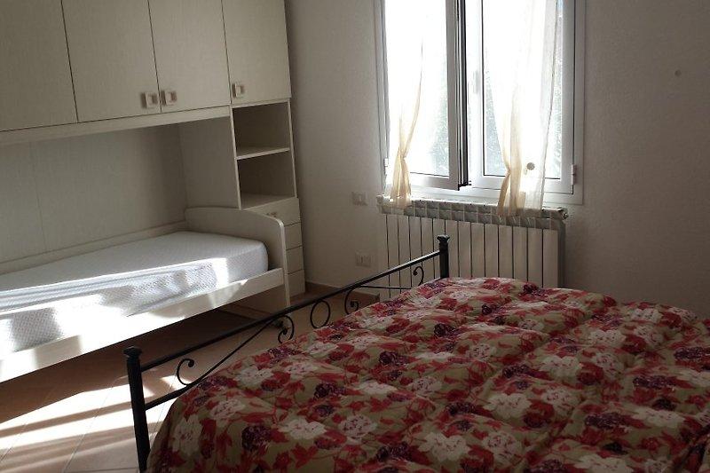 Doppelzimmer + 2 Einzelbetten