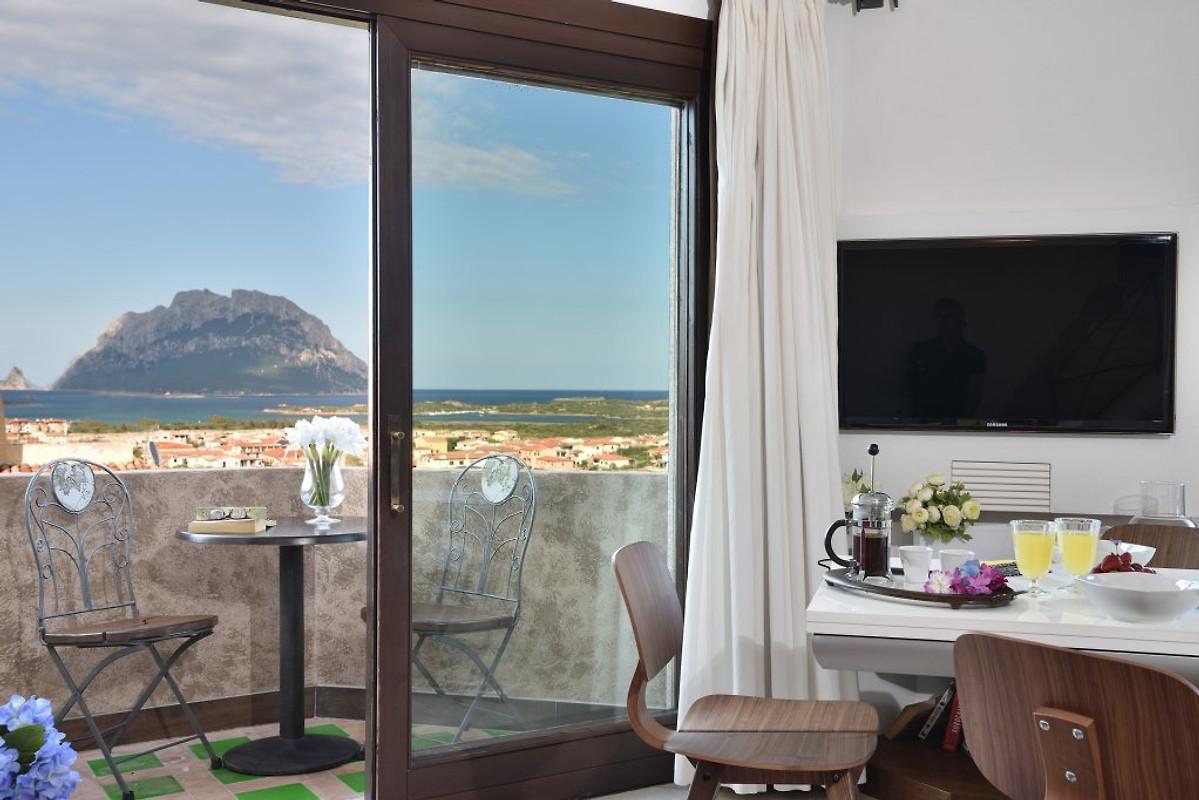 apartment der traum ferienwohnung in porto san paolo mieten. Black Bedroom Furniture Sets. Home Design Ideas