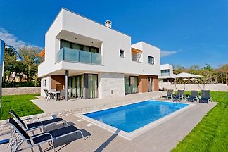 A four bedroom, four bathroom air-conditioned modern new villa with pool and own garden, one of six on a gated estate, 400 metres from the beach.