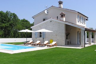 A new luxury traditionally built stone villa in the countryside of south-east Istria. 3 bedrooms, 3 bathrooms, garden and pool, WiFi. Air-conditioned.