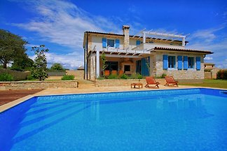 Modern four bedroom, three bathrooms, air-conditioned Istrian villa in the heart of countryside, WiFi, large garden, pool, sauna, pet friendly.