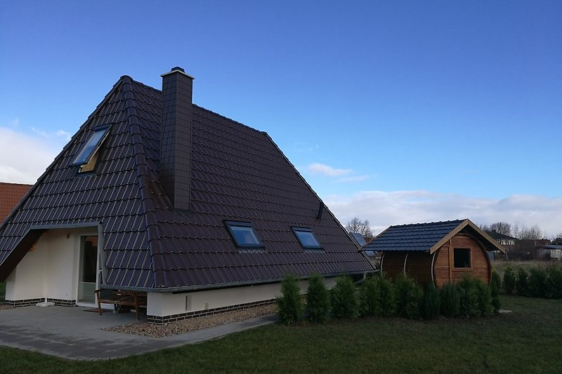 Ferienhaus mit Fass-Sauna