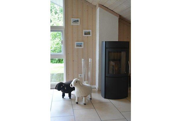 wohlf hl holzhaus lemkendorf ferienhaus in lemkendorf mieten. Black Bedroom Furniture Sets. Home Design Ideas