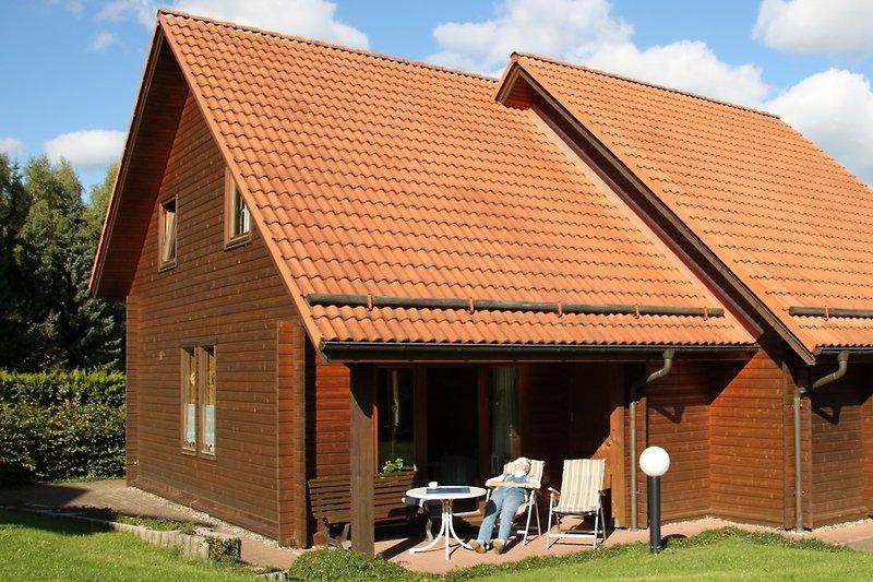 Blockhaus am Waldesrand Terrasse zum Süden