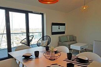 Traumhafte Maisonette-Ferienwohnungen mit Panorama-Meerblick. Die Ferienwohnungen liegen in einem neu errichteten Gebäude am Jachthafen, direkt am Wasser.