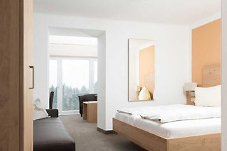 Panoramazimmer mit Wintergarten
