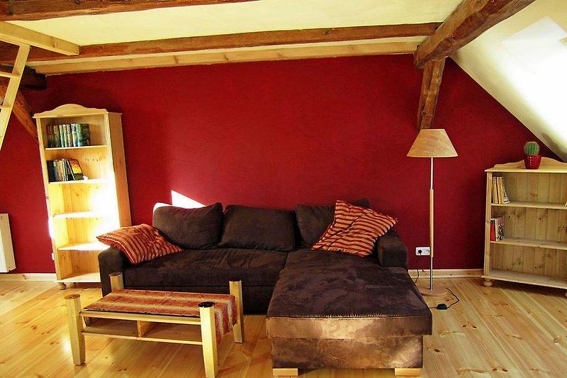 Couch in der Wohnstube mit Aufbettungsmöglichkeit für zwei Gäste