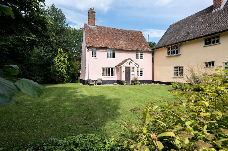 ...a pretty pink Suffolk cottage